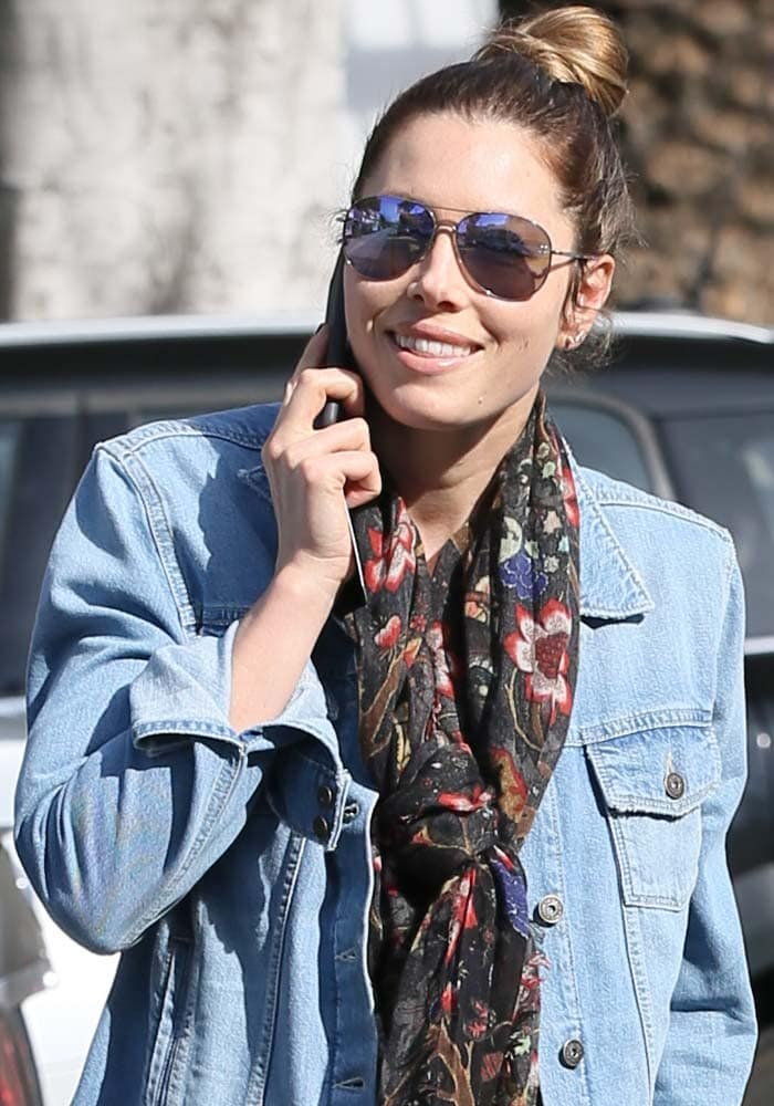 Jessica Biel wears a floral scarf and sunglasses from Victoria Beckham