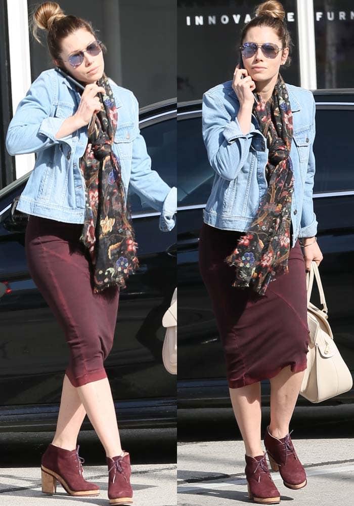 Jessica Biel styled a burgundy dress with a denim jacket