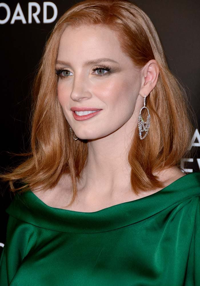 Jessica Chastain contrasts her red hair with an emerald green dress at the 2015 National Board Of Review Gala