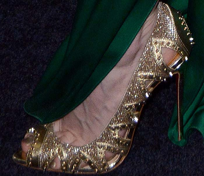 Jessica Chastain's feet in gold Christian Louboutin pumps
