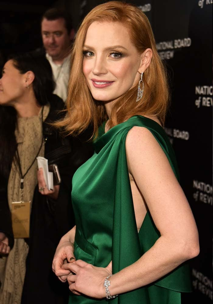 Jessica Chastain accessorizes with sparkling earrings and a bracelet
