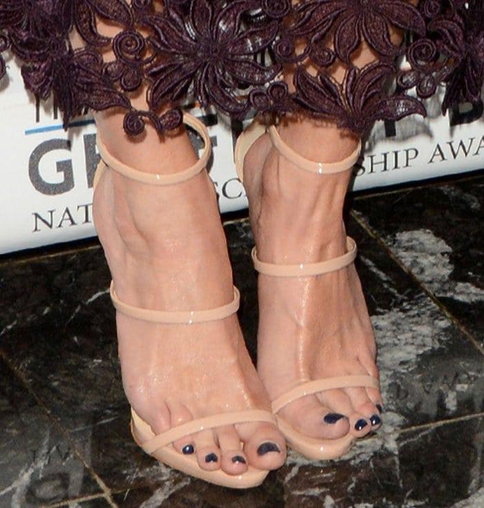 Jessica Simpson's feet in strappy nude Giuseppe Zanotti sandals