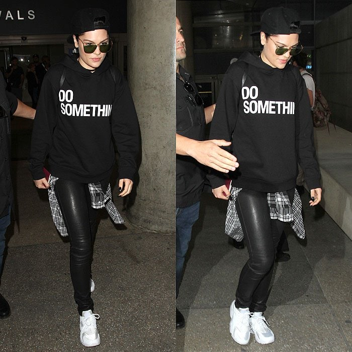 Jessie J wears white sneakers with a statement-printed sweater