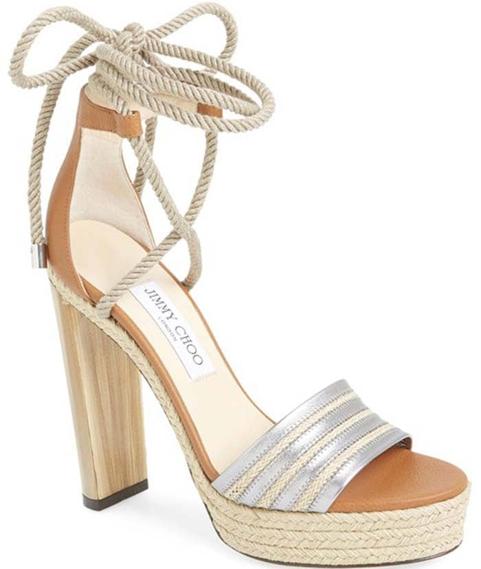 A scene-stealing sandal boasts tons of summer-chic style with its braided jute platform and ropey wrapround ankle ties, while a sky-high marbled heel gives an alluring, eye-catching lift