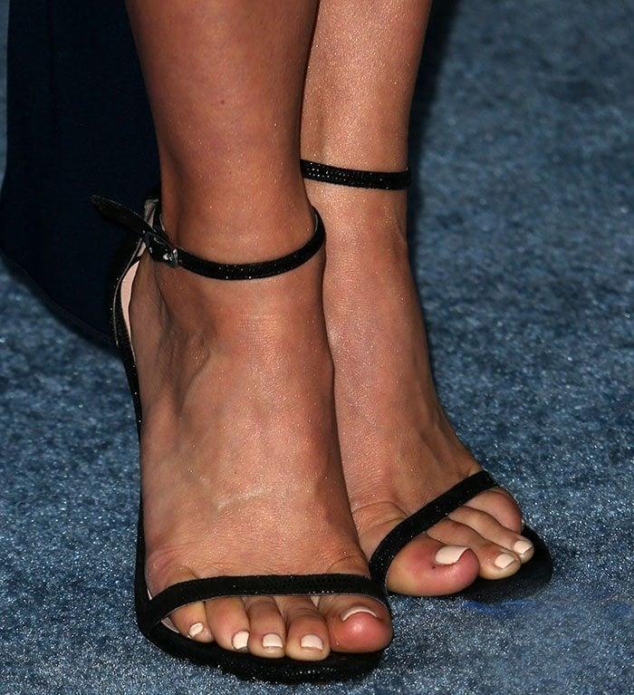 Julianne Hough's feet in minimalist Stuart Weitzman sandals