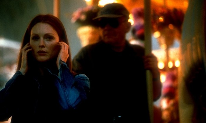 Anthony Hopkins as Dr. Hannibal Lecter / Dr. Fell and Julianne Moore as Clarice Starling in the 2001 American thriller film Hannibal