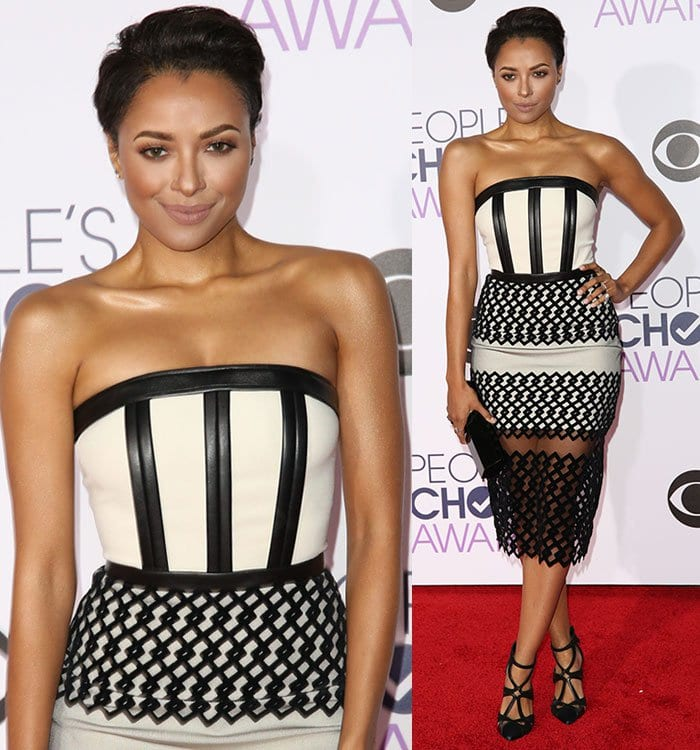 Kat Graham wears a pair of strappy pumps with her David Koma dress