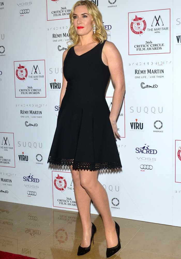 Kate Winslet flaunted her legs in a black flare mini dress