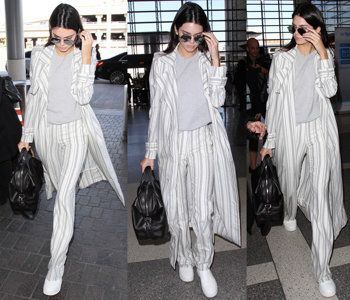 Kendall Jenner wears a $5,000-plus ensemble containing pieces from Sally LaPointe as she arrives at LAX