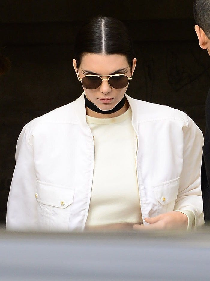 Kendall Jenner exits the venue for the Chanel haute couture spring/summer 2016 fashion show
