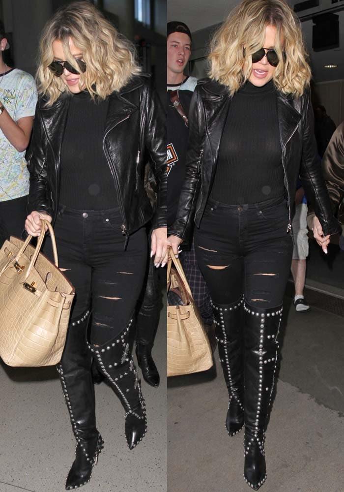 Khloe Kardashian arrives at LAX in an all-black attire including a leather Balenciaga jacket