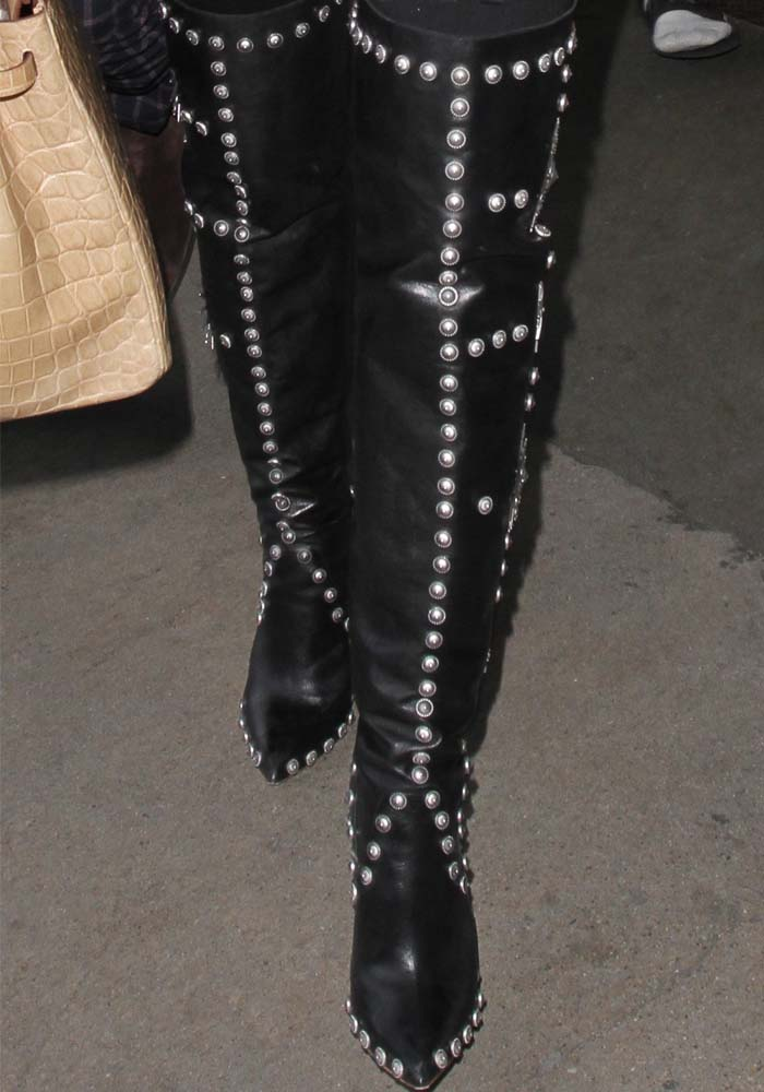 Khloe Kardashian wears a pair of studded Fausto Puglisi boots