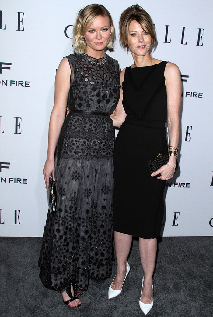 Kirsten Dunst and Elle Editor-in-Chief Robbie Myers pose for photos at Elle's Women in Television celebration