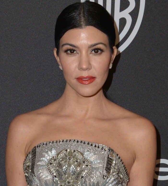 Kourtney Kardashian wears her hair up