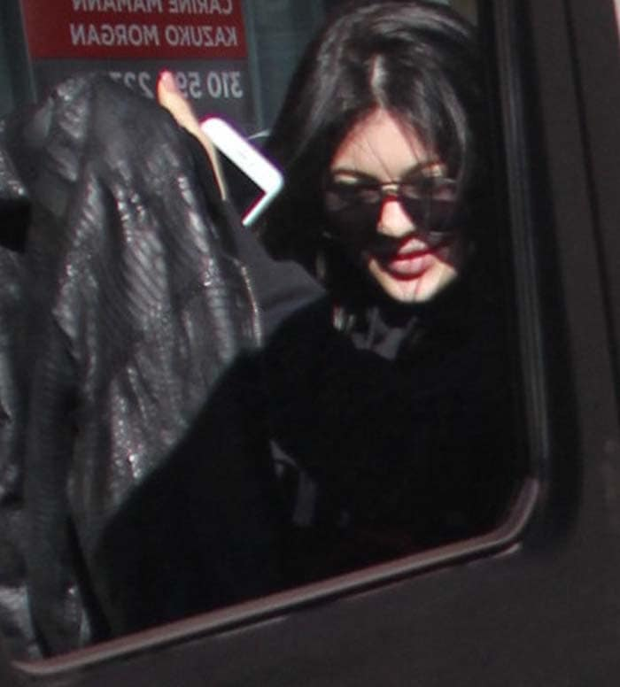Kylie Jenner leaves her hair down as she exits a building in Beverly Hills