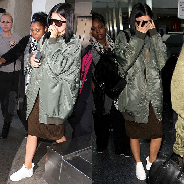 Kylie Jenner wears a bomber jacket at Los Angeles International Airport (LAX)