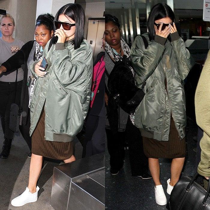 Kylie Jenner white sneakers bomber jacket