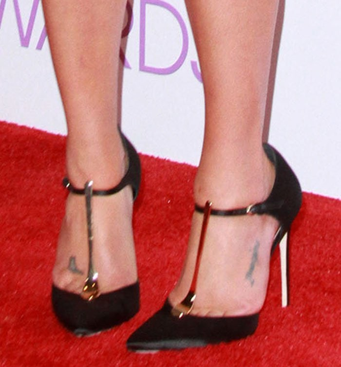 Lea Michele displays her feet in black suede Brian Atwood pumps