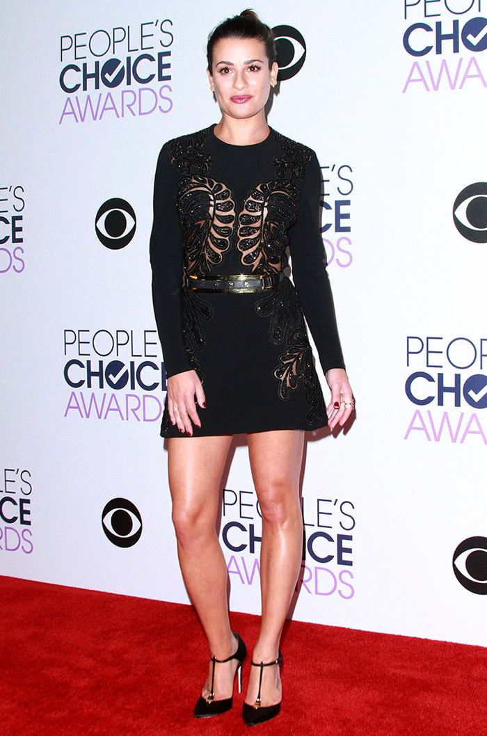 Lea Michele shows off her toned legs on the red carpet in an Elie Saab dress