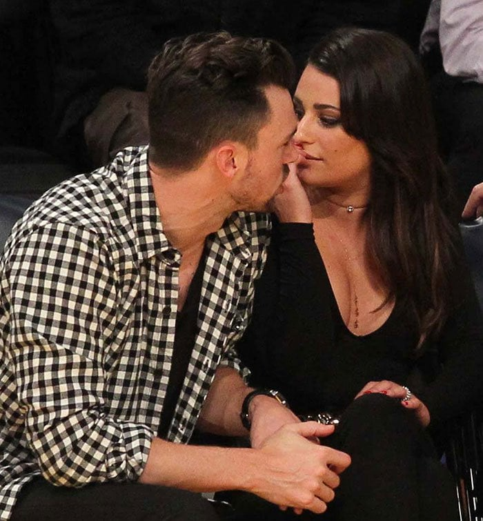 Matthew Paetz leans in to give his girlfriend Lea Michele a kiss while watching the Los Angeles Lakers play The Golden State Warriors