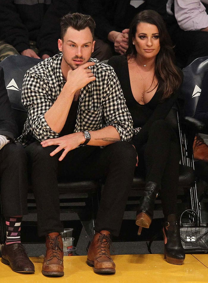 Lea Michele revealed cleavage in a low-cut scoop-neck long-sleeved black shirt