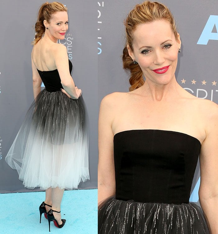 Leslie Mann wears her hair up in an elegant ponytail and sports bold pink lipstick