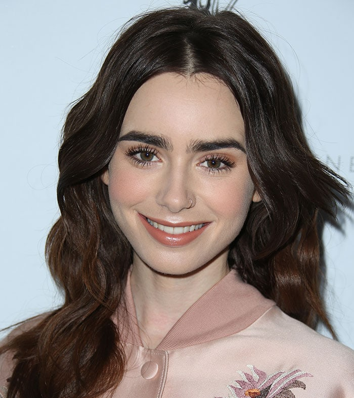 Lily Collins shows off her signature eyebrows with her hair down