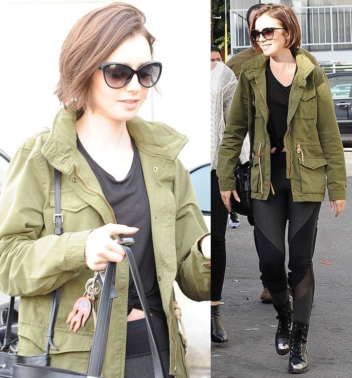Lily Collins wears an olive green Levi's jacket and a pair of black leggings