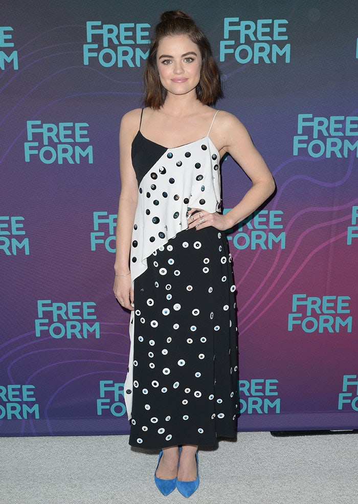 Lucy Hale adds a pop of color to her black-and-white Tanya Taylor dress