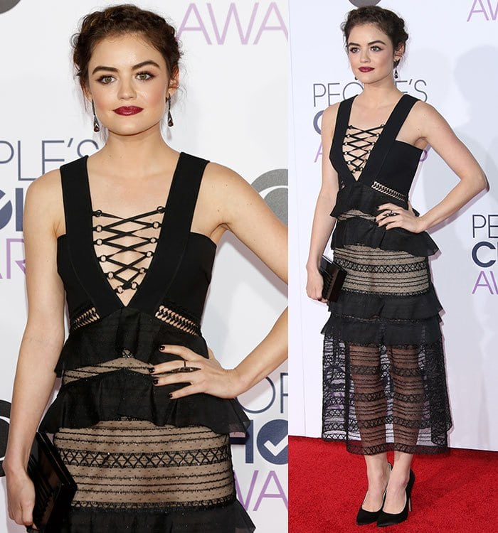 Lucy Hale shows off the lace-up detail on her black lace Self-Portrait dress