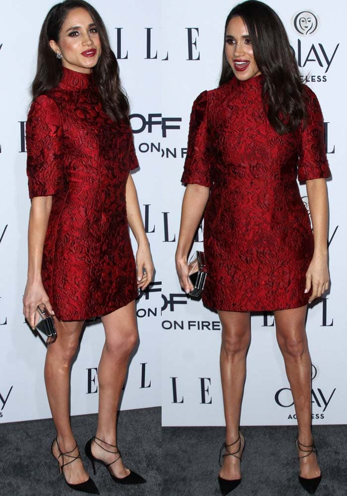 Meghan Markle wearinga red embroidered dress by Dolce & Gabbana and earrings from Dannijo