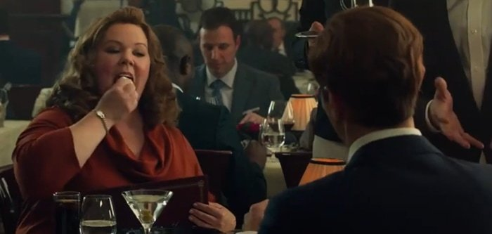 Melissa McCarthy tries to eat a hand towel in the action-comedy spy film Spy
