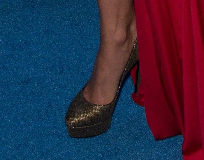 Michelle Rodriguez showed off her feet in black and gold platform Casadei pumps