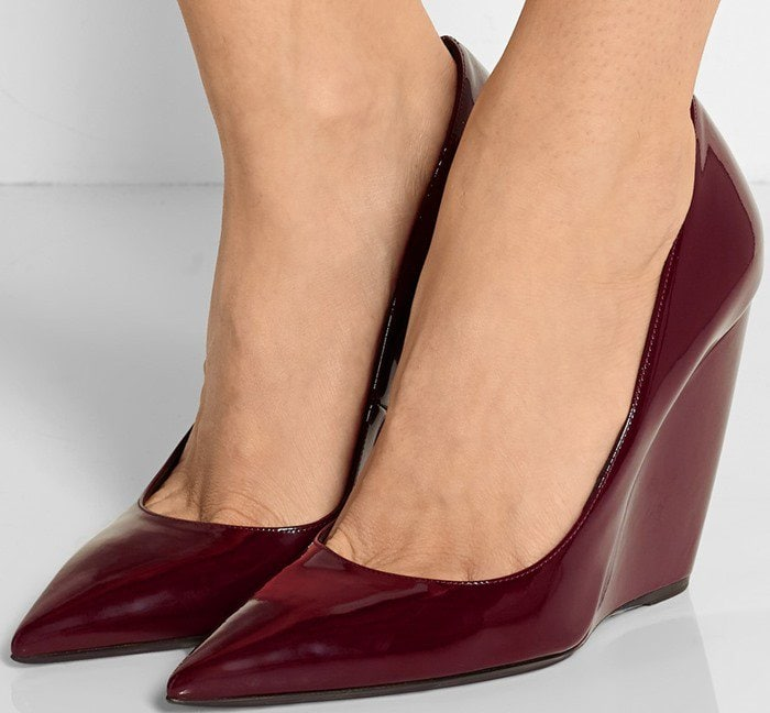 Nicholas Kirkwood's burgundy patent-leather 'Lizy' pumps have been faultlessly handcrafted in Italy with a stable wedge heel
