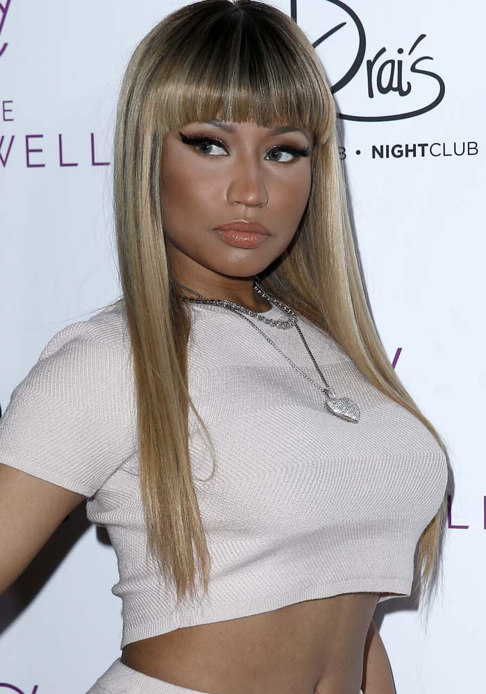 Nicki Minaj wears her hair down as she poses at Drai's Nightclub Las Vegas