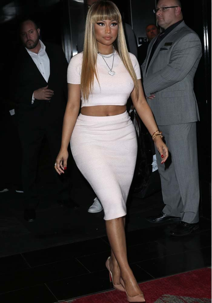 Nicki Minaj wears Christian Louboutin pumps with a crop-top-and-skirt set