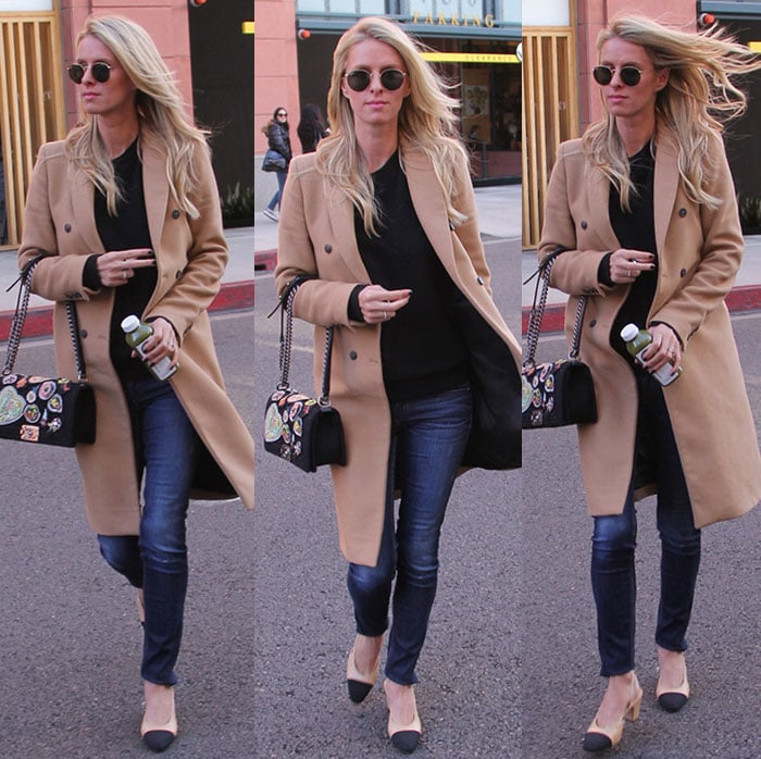 Nicky Hilton wears a pair of neutral Chanel pumps with her black-and-camel ensemble