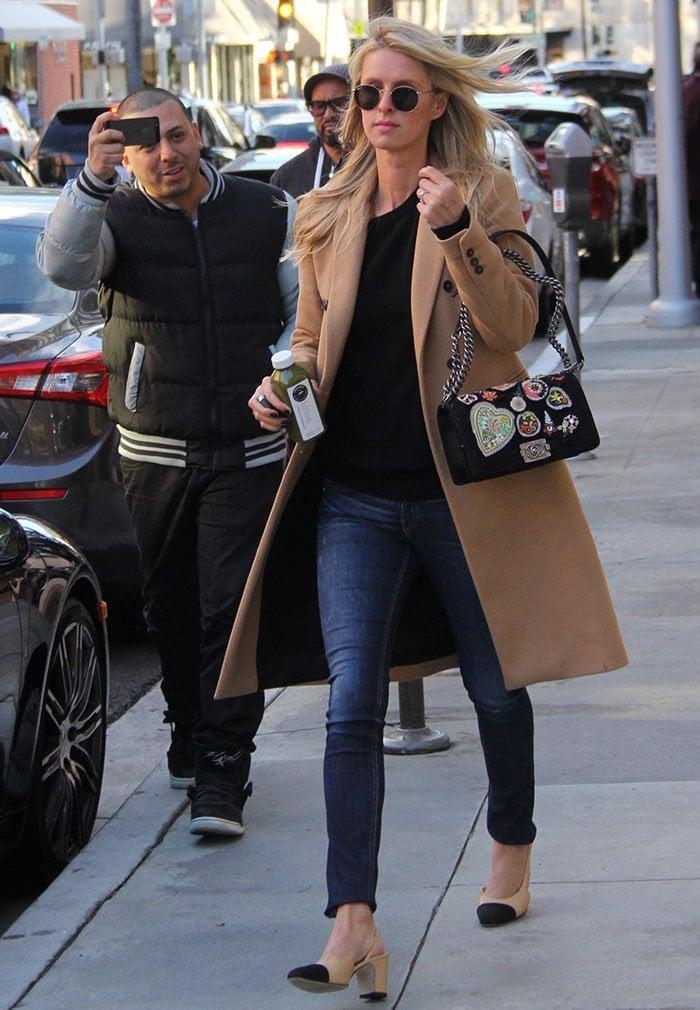 Nicky Hilton wears her blonde hair down as she runs errands