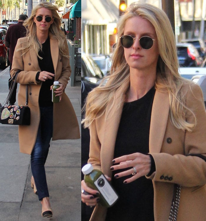 Nicky Hilton carries a bottle of juice in a camel coat and a pair of Rag & Bone skinny jeans