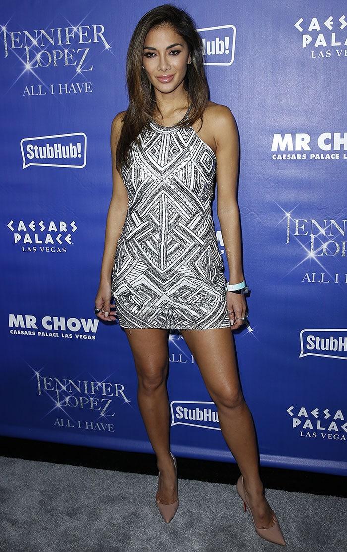 Nicole Scherzinger flaunted her legs in a geometric-patterned dress