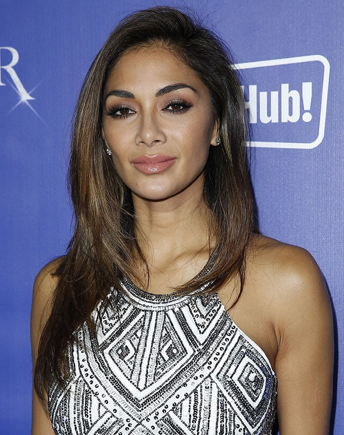 Nicole Scherzinger with kohl-rimmed eyes and shimmering pink pout