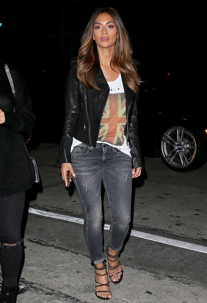 Nicole Scherzinger wears a Union Jack-emblazoned shirt under a black leather biker jacket out in Los Angeles
