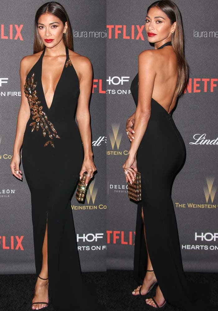 Nicole Scherzinger wears a plunging Alex Perry dress on the carpet of a Golden Globes after-party