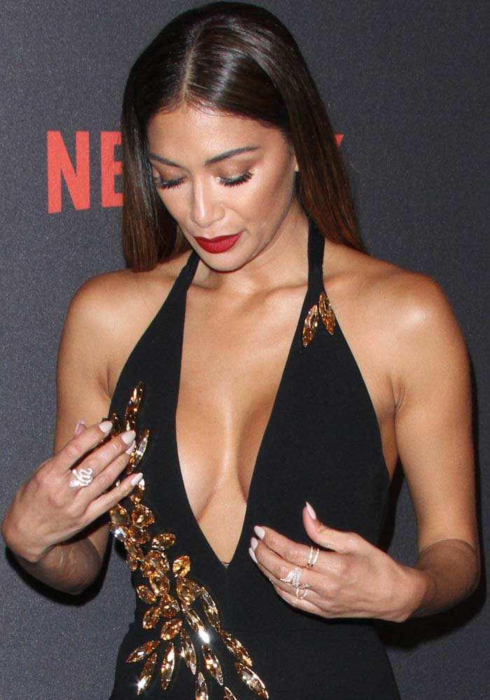 Nicole Scherzinger shows off a slew of sparking rings and some cleavage in an embellished black dress