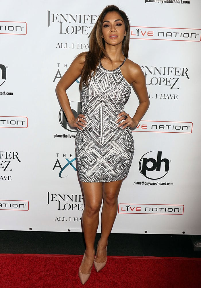 Nicole Scherzinger flaunted her legs in a glittery halter mini dress