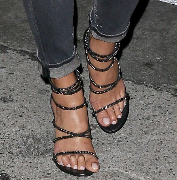 Nicole Scherzinger's feet in strappy black Stuart Weitzman XChain sandals