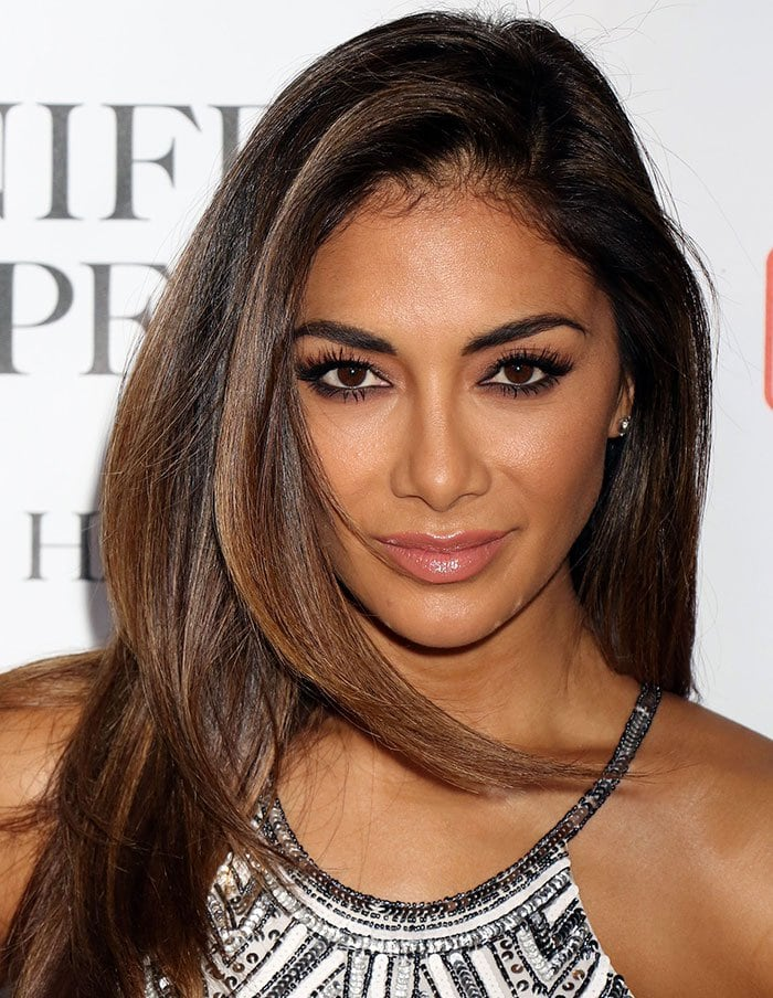 Nicole Scherzinger's brunette hair was worn loose and parted to the side