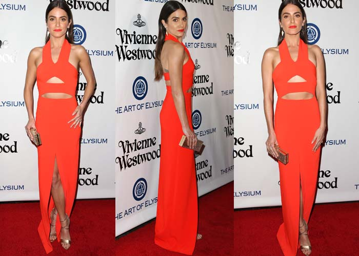 Nikki Reed shows off her legs in a gorgeous orange Solace London dress