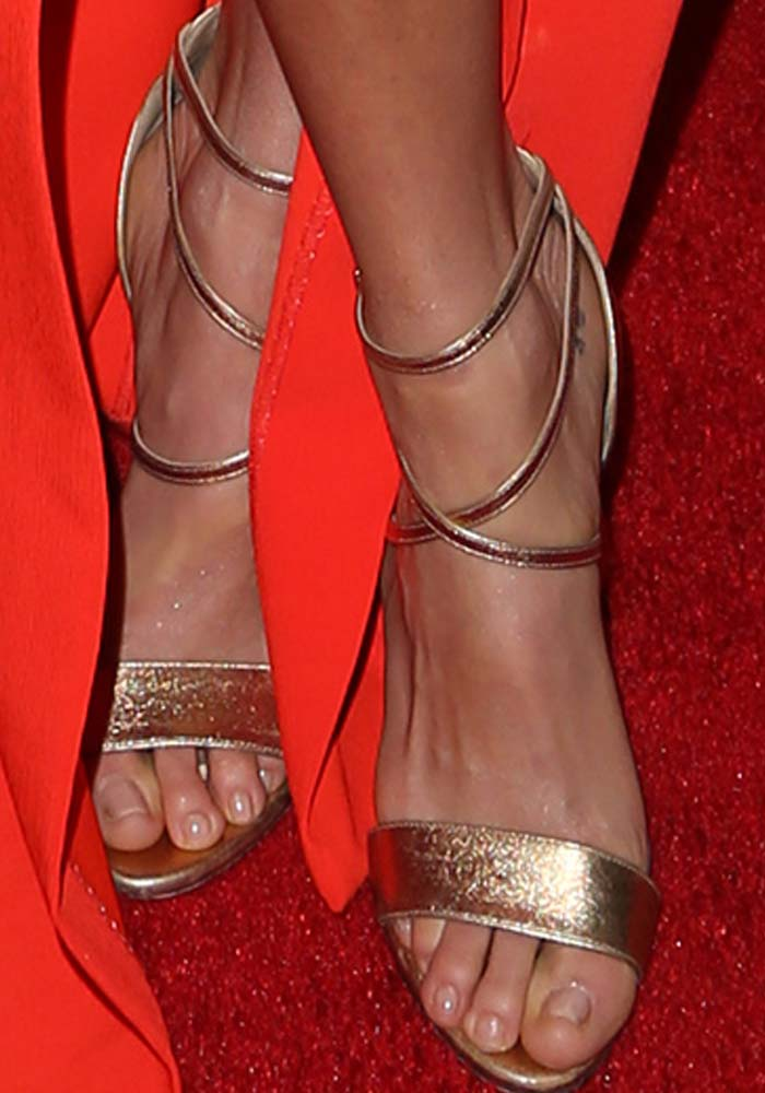 Nikki Reed's feet in gold Brian Atwood heels