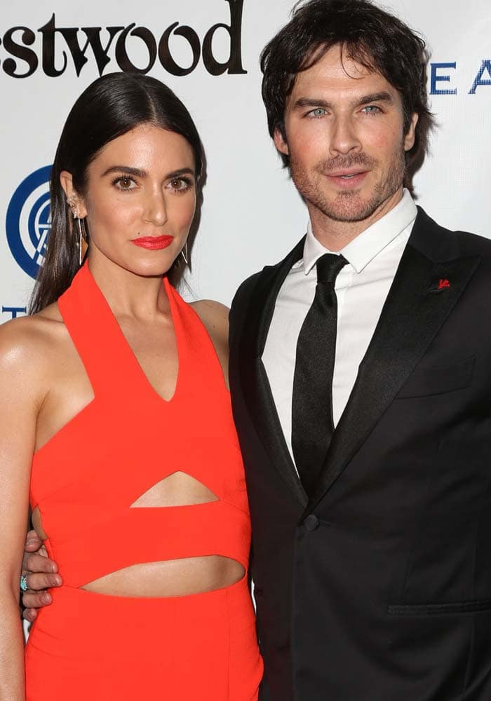 Nikki Reed and Ian Somerhalder pose for photos together on the red carpet